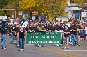 Band leading parade down street